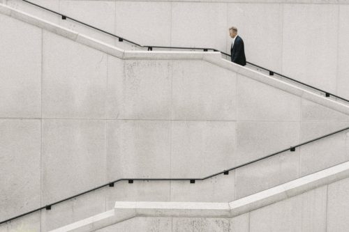 Business man climbing marble stairs